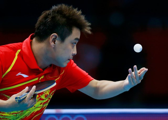 China's Wang Hao serves to Japan's Seiya Kishikawa in their men's singles quarterfinals table tennis match at the ExCel venue during the London 2012 Olympic Games